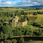 Doune Castle is a medieval stronghold near the village of Doune, in the Stirling district of central Scotland. The castle is sited on a wooded bend where the Ardoch Burn flows into the River Teith